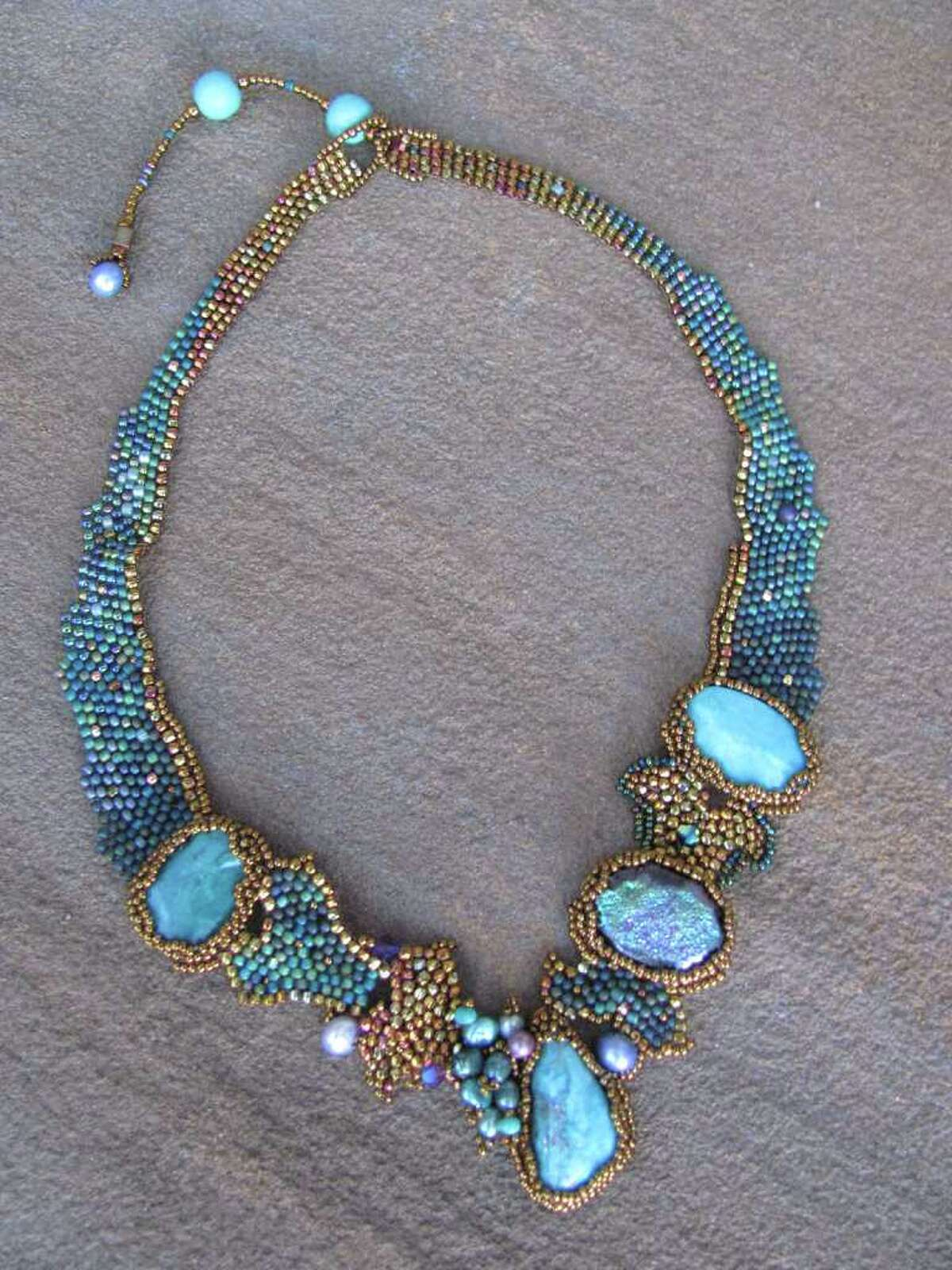 Southern Skies woven necklace by Amolia Willowsong, shown in Gallery of the Mountains in Asheville, N.C.