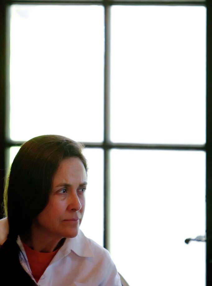 "Poets Naomi Shihab Nye appears before a discussion of ""Poetry and Politics"" at the Holt Center at Trinity University on Saturday, Oct. 31, 2009. Kin Man Hui/kmhui@express-news.net Photo: Kin Man Hui, San Antonio Express-News / San Antonio Express-News"