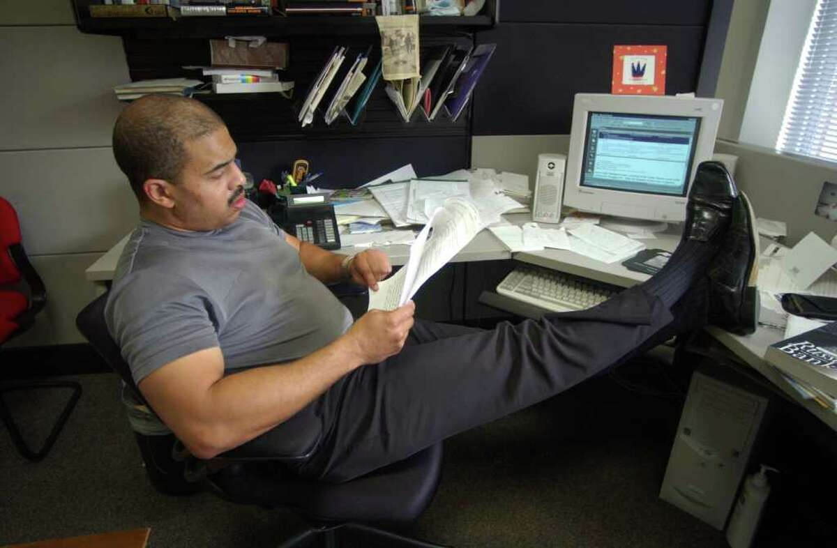Archive: San Antonio Express-News columnist Cary Clack goes over a story in his office.