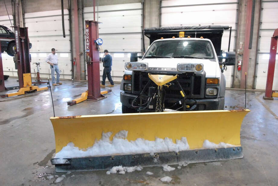 A plow being repaired Friday at the John J. Kennedy Fleet Maintenance and Highway facility in Greenwich last winter. Photo: Greenwich Time File / Greenwich Time Contributed