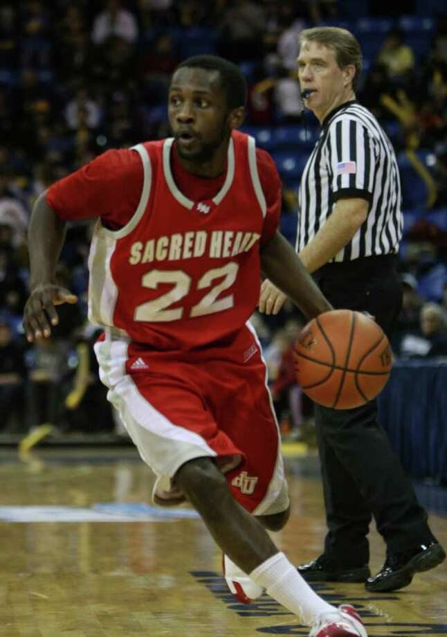Sacred Heart's Chauncey Hardy plays in a 2009 game against Quinnipiac. Hardy seemed to have found his stride overseas soon before he was struck in a Romania bar, leading to his death. Photo: Sacred Heart University\Stan God, Courtesy Of Sacred Heart University\ / Connecticut Post Contributed (C) 2010 Stan Godlewski