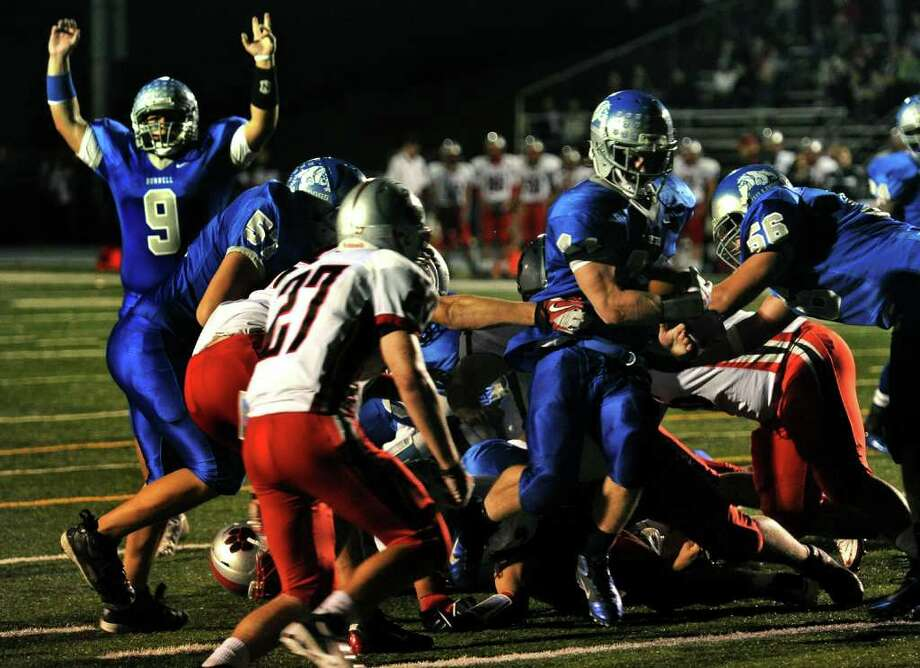 Bunnell's #44 Joseph Bivona, at right, breaks through the middle for a touchdown, during boys football action against Pomperaug in Stratford, Conn. on Friday October 14, 2011. Photo: Christian Abraham / Connecticut Post