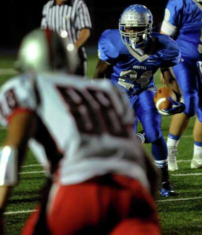 Bunnell's #24 David Camille carries the ball towards a Pomeraug defender, during boys football action in Stratford, Conn. on Friday October 14, 2011. Photo: Christian Abraham / Connecticut Post
