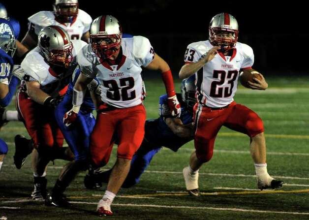Pomperaug's #23 Dylan McAllister, right, manuevers around with the ball to gain some yardage, during boys football action against Bunnell in Stratford, Conn. on Friday October 14, 2011. Photo: Christian Abraham / Connecticut Post