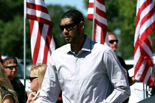 Tim Duncan attends the funeral for LCpl. Benjamin Schmidt at Ft. Sam Houston National Cemetery Friday Oct. 14, 2011.  Schmidt was killed in action on October 6 while on patrol in Afghanistan.  The 24-year-old was a graduate of Alamo Heights High School and attended Texas Christian University.  He was stationed out of Camp Pendleton, California.  Serving his second tour in Afghanistan, Schmidt deployed in September with the 2nd Battalion, 4th Marine Regiment. Photo: HELEN L. MONTOYA, Helen L. Montoya/hmontoya@express-news.net / SAN ANTONIO EXPRESS-NEWS