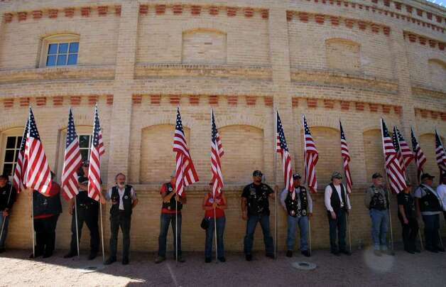 Members of the Patriot Guard Riders line the exterior of the Pearl Stables during a memorial service for LCpl. Benjamin Schmidt on Friday Oct. 14, 2011.  Schmidt was killed in action on October 6 while on patrol in Afghanistan.  The 24-year-old was a graduate of Alamo Heights High School and attended Texas Christian University.  He was stationed out of Camp Pendleton, California.  Serving his second tour in Afghanistan, Schmidt deployed in September with the 2nd Battalion, 4th Marine Regiment. Photo: HELEN L. MONTOYA, Helen L. Montoya/hmontoya@express-news.net / SAN ANTONIO EXPRESS-NEWS