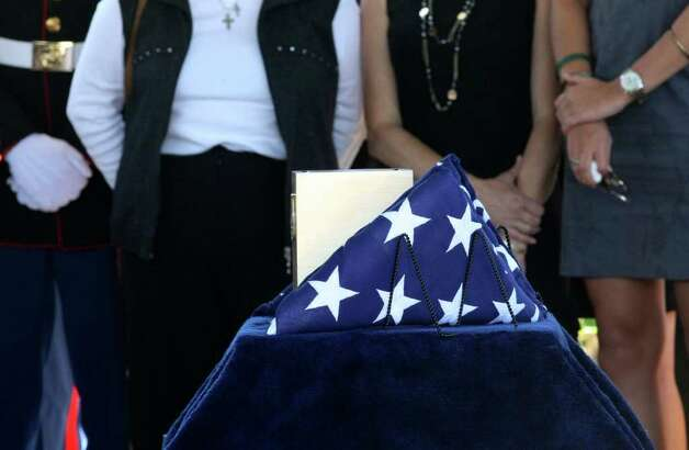 LCpl. Benjamin Schmidt is laid to rest during a funeral at Ft. Sam Houston National Cemetery Friday Oct. 14, 2011. Schmidt was killed in action on October 6 while on patrol in Afghanistan.  The 24-year-old was a graduate of Alamo Heights High School and attended Texas Christian University.  He was stationed out of Camp Pendleton, California.  Serving his second tour in Afghanistan, Schmidt deployed in September with the 2nd Battalion, 4th Marine Regiment. Photo: HELEN L. MONTOYA, Helen L. Montoya/hmontoya@express-news.net / SAN ANTONIO EXPRESS-NEWS