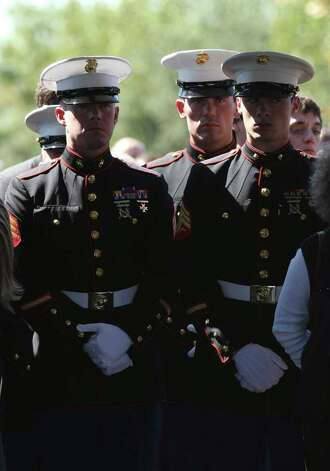 Marines stand in the crowd during services at Sam Houston National Cemetery Friday Oct. 14, 2011 for LCpl Benjamin Schmidt.  Schmidt was killed in action on October 6 while on patrol in Afghanistan.  The 24-year-old was a graduate of Alamo Heights High School and attended Texas Christian University.  He was stationed out of Camp Pendleton, California.  Serving his second tour in Afghanistan, Schmidt deployed in September with the 2nd Battalion, 4th Marine Regiment. Photo: HELEN L. MONTOYA, Helen L. Montoya/hmontoya@express-news.net / SAN ANTONIO EXPRESS-NEWS