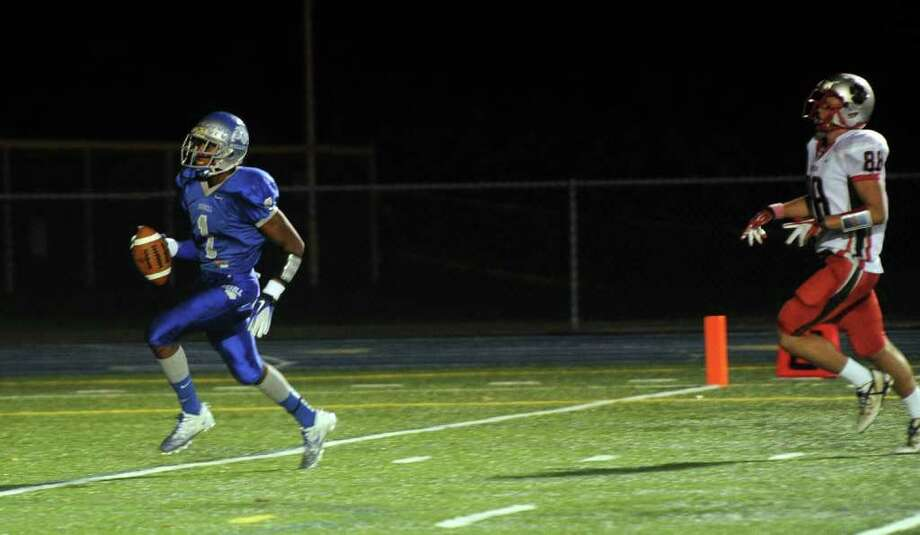 Highlights from boys football action between Bunnell and Pomperaug in Stratford, Conn. on Friday October 14, 2011. Bunnell's #1 Jawad Chisholm, left, carries the ball to the endzone for a touchdown with Pomperaug's #88 Brett Gaughan failing to reach him. Photo: Christian Abraham / Connecticut Post