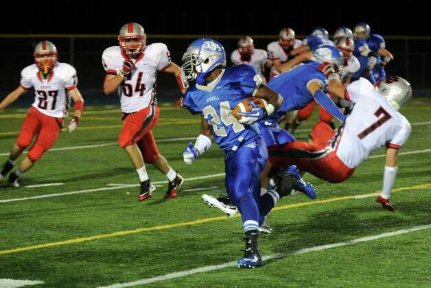 Highlights from boys football action between Bunnell and Pomperaug in Stratford, Conn. on Friday October 14, 2011. Bunnell's #24 David Camille carries the ball in an attempt to get the two point conversion. Photo: Christian Abraham / Connecticut Post