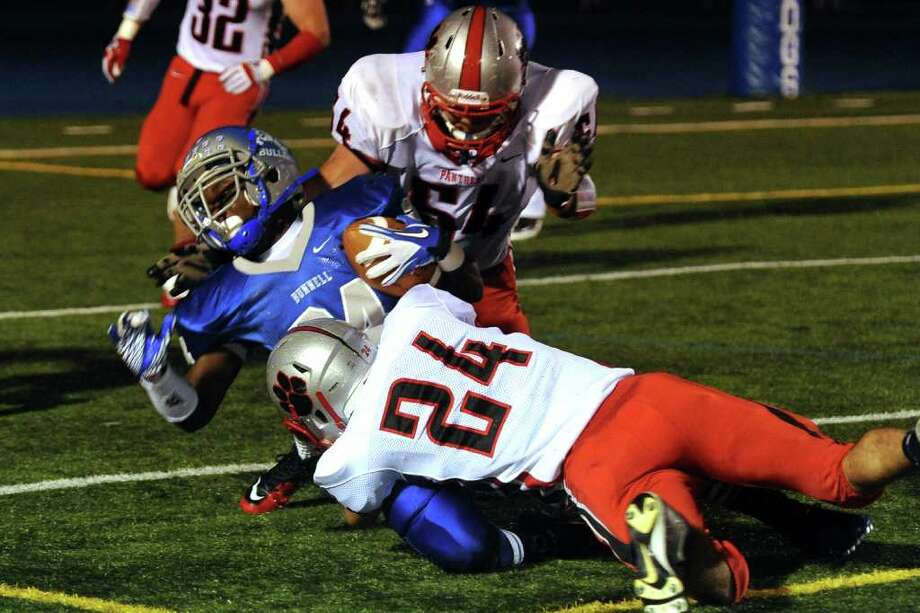 Highlights from boys football action between Bunnell and Pomperaug in Stratford, Conn. on Friday October 14, 2011. Bunnell's #24 David Camille is tackled by Pomperaug players in a failed attempt to get the two point conversion. Photo: Christian Abraham / Connecticut Post
