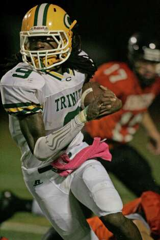 Trinity Catholic RB Donovan Stephensen looks upfield for running room during third quarter action against Stamford HS. Photo: J. Gregory Raymond /  J. Gregory Raymond/Stamford Advocate Freelance