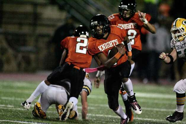 Stamford High School QB Bryan Boderick runs for a 3rd quarter gain during intercity football action against Trinity Catholic. Stamford, down 13-0 in the first quarter, rallied around Boderick's running ability to win 42-16. Photo: J. Gregory Raymond / J. Gregory Raymond/Stamford Advocate Freelance