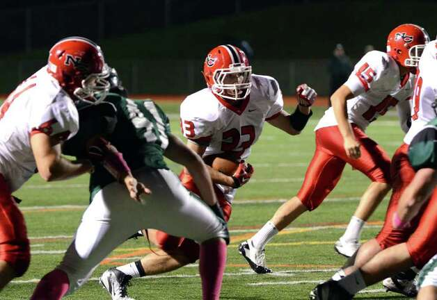 New Canaan's Louis Hagopian (33) carries the ball during the football game against Norwalk at Norwalk High School on Friday, Oct. 14, 2011. Photo: Amy Mortensen / Connecticut Post Freelance