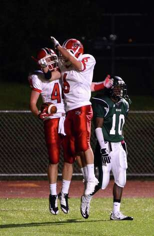 New Canaan's Connor Kilbane (44) and Teddy Bossidy (6) celebrate a touchdown in the endzone during the football game against Norwalk at Norwalk High School on Friday, Oct. 14, 2011. Photo: Amy Mortensen / Connecticut Post Freelance