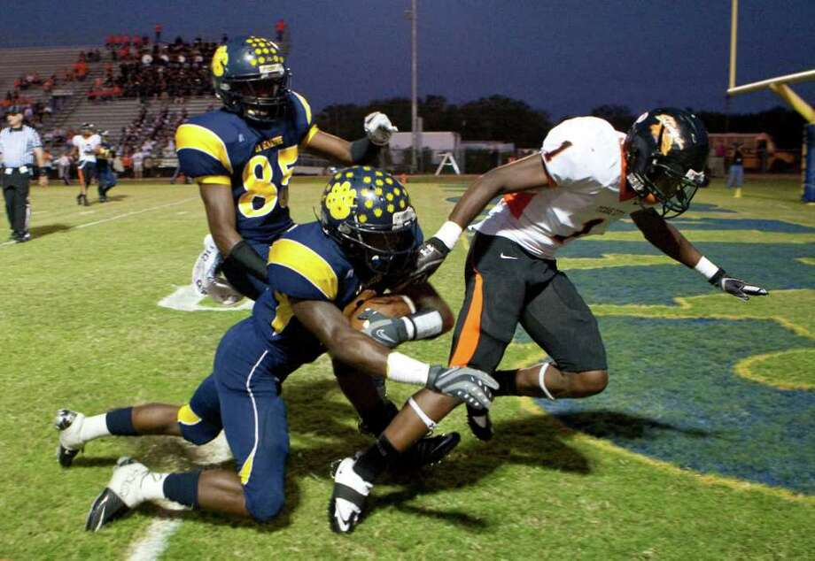 La Marque High School running back Tim Wright (2), runs into Texas City High School's Franklin Branch for a touchdown during he first quarter of a 24 4-A high school football game at Etheredge Stadium, Friday, Oct. 14, 2011,  in La Marque. Photo: Nick De La Torre, Houston Chronicle / © 2011  Houston Chronicle