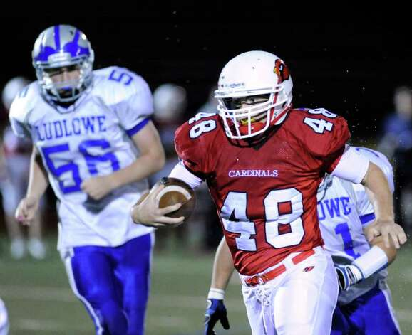 Greenwich High School running back Shane Nastahowski, # 48, beats Ben Brzoski, # 56 of Fairfield Ludlowe High School, to score a lst quarter touchdown during High school football game between Greenwich High School and Fairfield Ludlowe High School at Greenwich, Friday night, Oct. 14, 2011. Photo: Bob Luckey / Greenwich Time