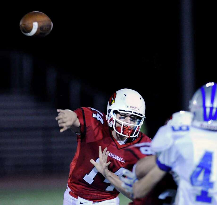 Greenwich High School quarterback Liam O'Neil, # 24, throws a pass during football game between Greenwich High School and Fairfield Ludlowe High School at Greenwich, Friday night, Oct. 14, 2011. Photo: Bob Luckey / Greenwich Time