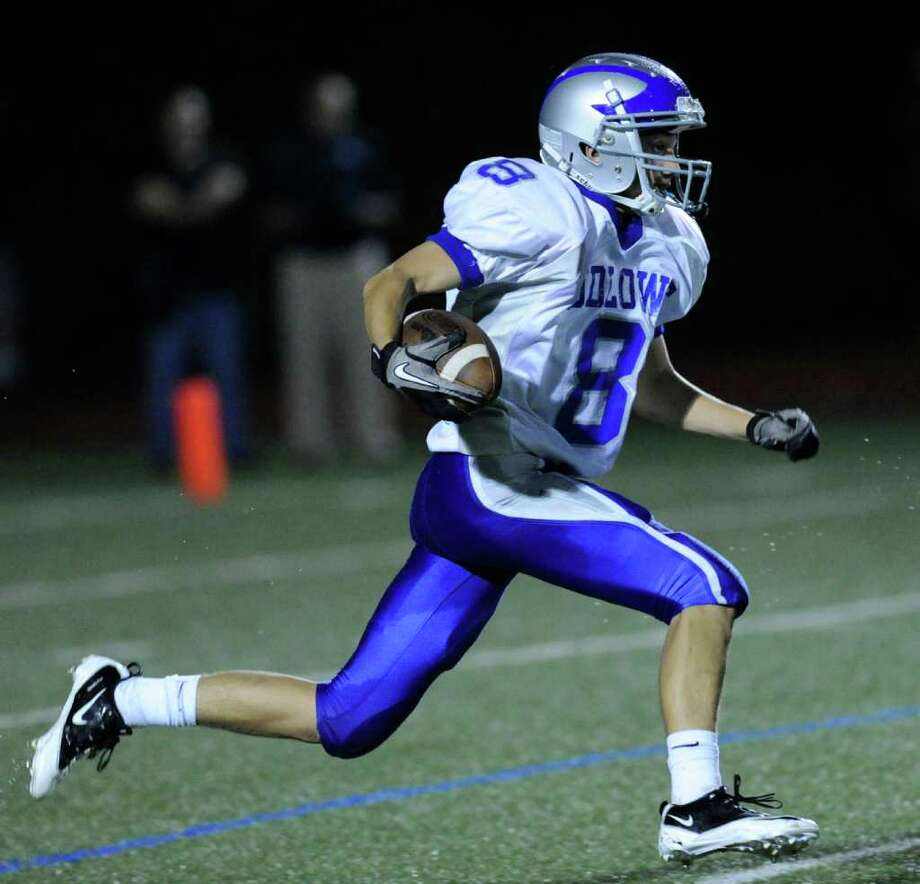 Danny Santella, # 8 of Fairfield Ludlowe High School returns a kick during football game between Greenwich High School and Fairfield Ludlowe High School at Greenwich, Friday night, Oct. 14, 2011. Photo: Bob Luckey / Greenwich Time