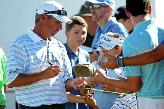 Fred Couples signs autographs after his round at the AT&T Championship at TPC San Antonio AT&T Canyons Course on October 12, 2011.  Tom Reel/Staff Photo: TOM REEL, Express-News / © 2011 San Antonio Express-News