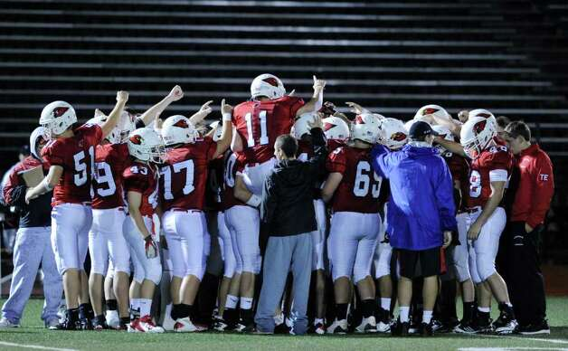 The Greenwich High School Cardinal football team during high school football game between Greenwich High School and Fairfield Ludlowe High School at Greenwich, Friday night, Oct. 14, 2011. Photo: Bob Luckey / Greenwich Time