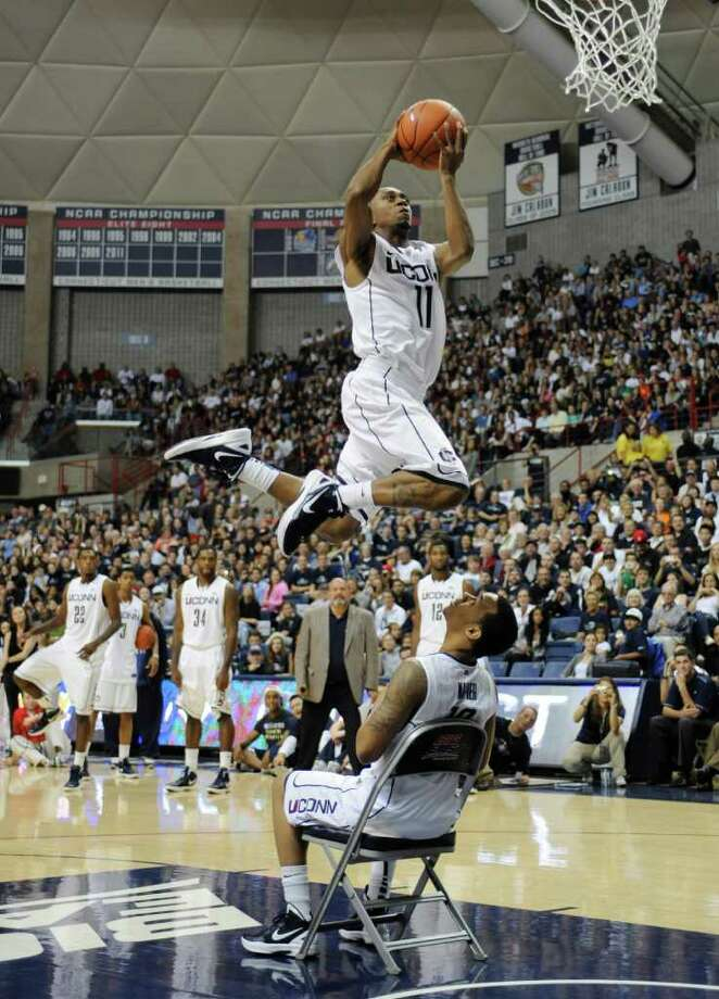 Connecticut's Ryan Boatright jumps over teammate Shabazz Napier during the slam dunk competition at the First Night NCAA college basketball exhibition in Storrs, Conn., Friday, Oct. 14, 2011. Boatright won the competition.  (AP Photo/Jessica Hill) Photo: Jessica Hill, AP / AP2011
