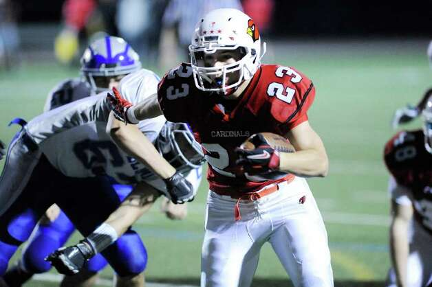 Runningback Mike Daly, # 23 of Greenwich High School in action during football game between Greenwich High School and Fairfield Ludlowe High School at Greenwich, Friday night, Oct. 14, 2011. Photo: Bob Luckey / Greenwich Time