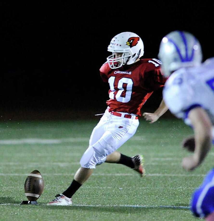 Jesse Adelberg, # 10 of Greenwich High School kicks-off during high school football game between Greenwich High School and Fairfield Ludlowe High School at Greenwich, Friday night, Oct. 14, 2011. Photo: Bob Luckey / Greenwich Time