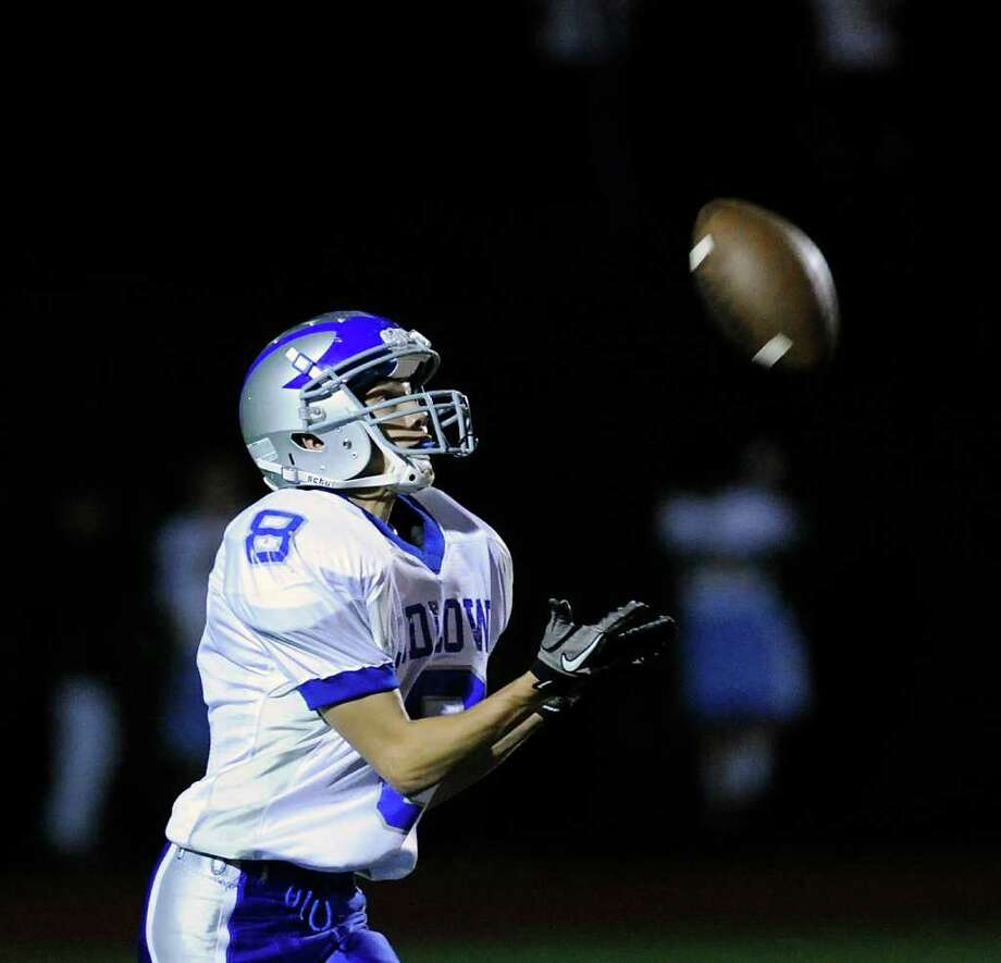 Dan Santella, # 8 of Fairfield Ludlowe High School receives a punt during high school football game between Greenwich High School and Fairfield Ludlowe High School at Greenwich, Friday night, Oct. 14, 2011. Photo: Bob Luckey / Greenwich Time