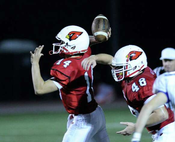 Left to right, QB Liam O'Neil and running back Shane Nastahowski of Greenwich High School, during high school football game between Greenwich High School and Fairfield Ludlowe High School at Greenwich, Friday night, Oct. 14, 2011. Photo: Bob Luckey / Greenwich Time