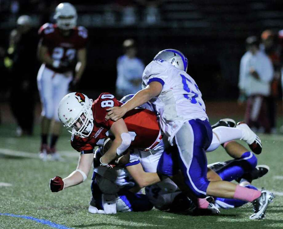 Joe Kelly, # 80 of Greenwich High School on a reception of a pass during high school football game between Greenwich High School and Fairfield Ludlowe High School at Greenwich, Friday night, Oct. 14, 2011. Photo: Bob Luckey / Greenwich Time