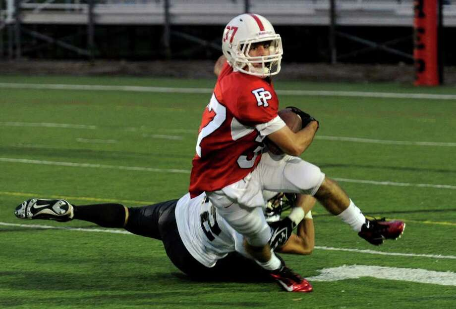 Fairfield Prep's #37 Joseph McBride is tackled by Xavier's #52 Ryan Craig, during boys football action at Fairfield University in Fairfield, Conn. on Friday October 14, 2011. Photo: Christian Abraham / Connecticut Post