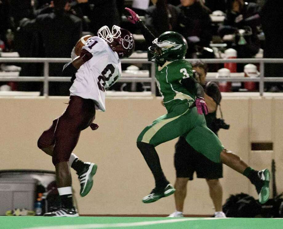 10/14/11: Wide receiver Kaleb Moore #81 of the Cy Fair Bobcat's scores on a 37 yard touchdown reception while defensive back Ronald Cole #3 of the Cy Falls Eagles defends on the play in a high school District 17-5A football game at Pridgeon Stadium in Houston, Texas. For to Chronicle :Thomas B. Shea Photo: For To Chronicle :Thomas B. Shea