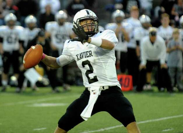 Xavier QB #2 Pat D'Amato prepares to pass the ball, during boys football action against Fairfield Prep at Fairfield University in Fairfield, Conn. on Friday October 14, 2011. Photo: Christian Abraham / Connecticut Post