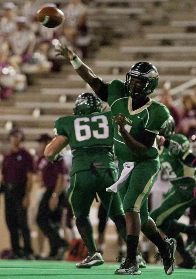 10/14/11: Quarterback Troy Mitchell #4 of the Cy Falls Eagles completes a pass against the Cy Fair Bobcat's in a high school District 17-5A football game at Pridgeon Stadium in Houston, Texas. For to Chronicle :Thomas B. Shea Photo: For To Chronicle :Thomas B. Shea