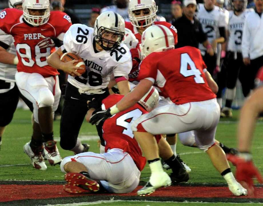 Xavier's #26 Mike Mastrioanni works to get through Fairfield Prep defense, during boys football action at Fairfield University in Fairfield, Conn. on Friday October 14, 2011. Photo: Christian Abraham / Connecticut Post