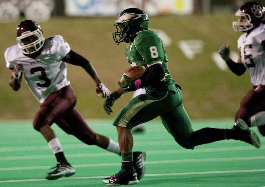 10/14/11: Running back Tre' Clark #8 of the Cy Falls Eagles runs after the catch against defensive back Dwight White #3 of the Cy Fair Bobcat's in a high school District 17-5A football game at Pridgeon Stadium in Houston, Texas. For to Chronicle :Thomas B. Shea Photo: For To Chronicle :Thomas B. Shea