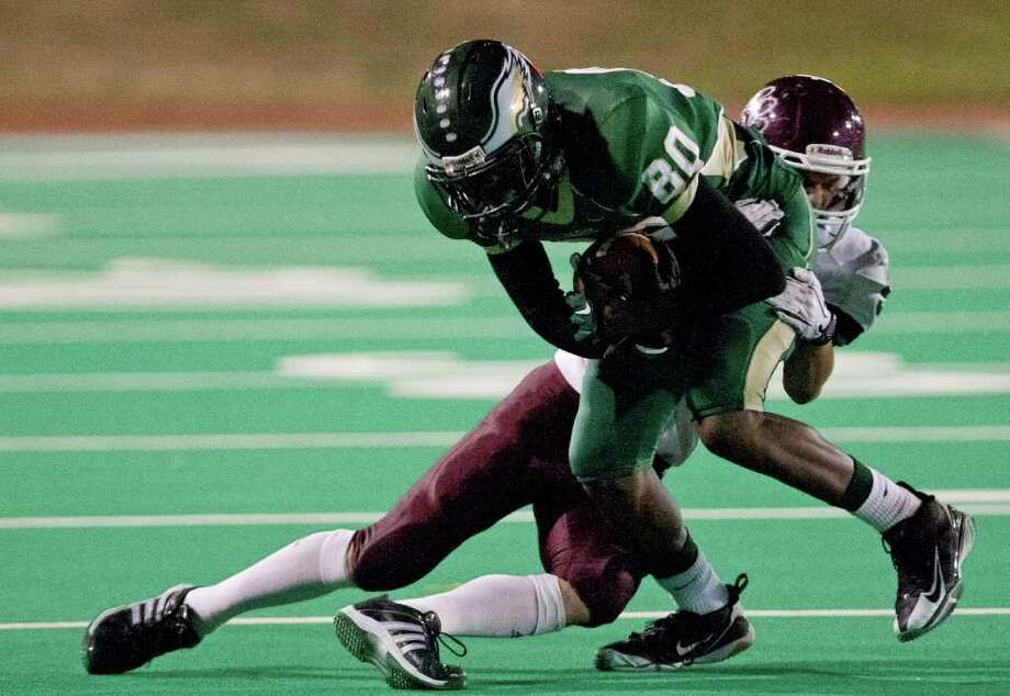 10/14/11: Wide receiver Temi Alaka #80 of the Cy Falls Eagles is tackled by defensive back Ryan Bradshaw #9 of the Cy Fair Bobcat's   in a high school District 17-5A football game at Pridgeon Stadium in Houston, Texas. For to Chronicle :Thomas B. Shea Photo: For To Chronicle :Thomas B. Shea