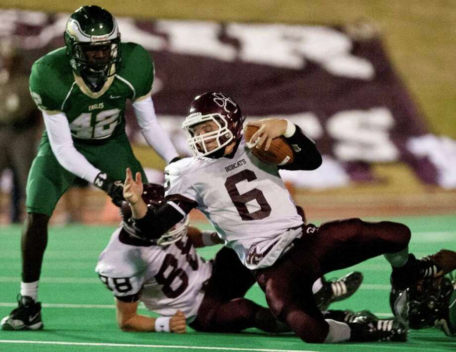 10/14/11: Quarterback Logan Taylor #6 of the Cy Fair Bobcat's is tripped up by the Cy Falls Eagles defense in a high school District 17-5A football game at Pridgeon Stadium in Houston, Texas. For to Chronicle :Thomas B. Shea Photo: For To Chronicle :Thomas B. Shea