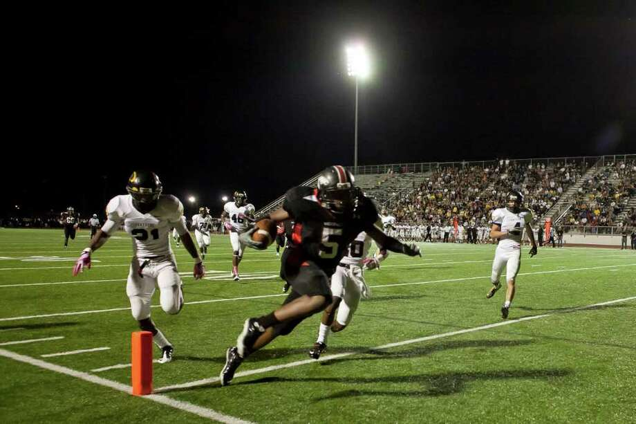 Westfield tightend Jordan Jones (5) runs in a touchdown against Klein Oak in another District 13-5A battle Friday night October 14, 2011 at Leonard George Stadium in Spring, TX. Klein Oak, which started 0-2 this season is now undefeated in district after beating three ranked teams. 