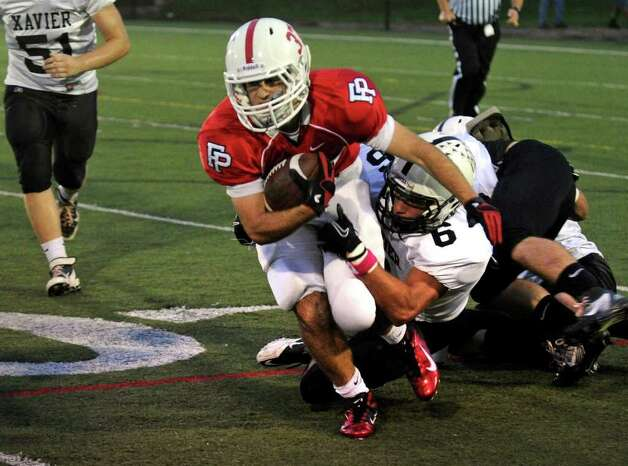 Fairfield Prep's #37 Joseph McBride is tackled by Xavier's #6 Ryan Murphy, during boys football action at Fairfield University in Fairfield, Conn. on Friday October 14, 2011. Photo: Christian Abraham / Connecticut Post
