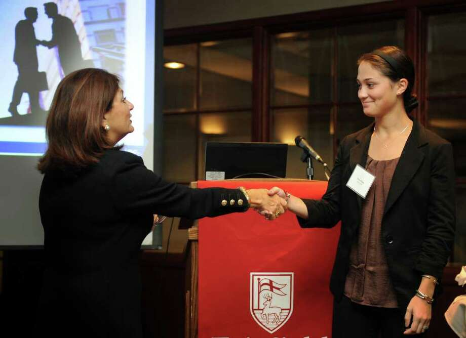 Ann Marie Sabath, author of Business Etiquette in Brief, demonstrates an introduction with student Devon Degen during Fairfield University's Competitive Edge Etiquette Dinner Wednesday, Oct. 12, 2011 at the Dolan School of Business. Photo: Autumn Driscoll