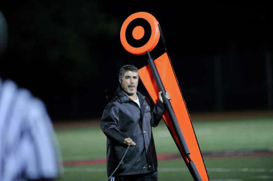 Gary Dell'abate of Old Greenwich works the chains during high school football game between Greenwich High School and Fairfield Ludlowe High School at Greenwich, Friday night, Oct. 14, 2011. Dell'abate's son, Jackson, plays on the Cardinal offensive line. Photo: Bob Luckey / Greenwich Time