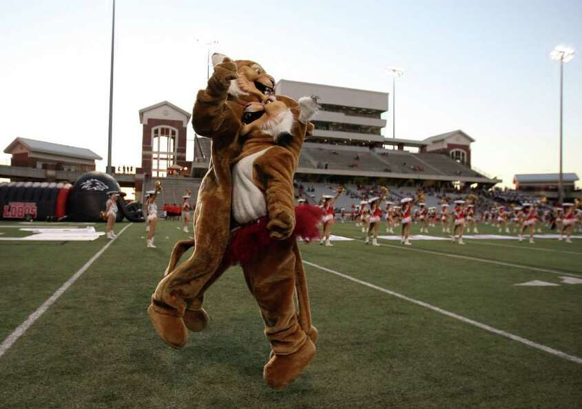 Cy-Woods mascots Alex Whitnah (left) and Arabella Cruz chest bump before the Wildcats' game against