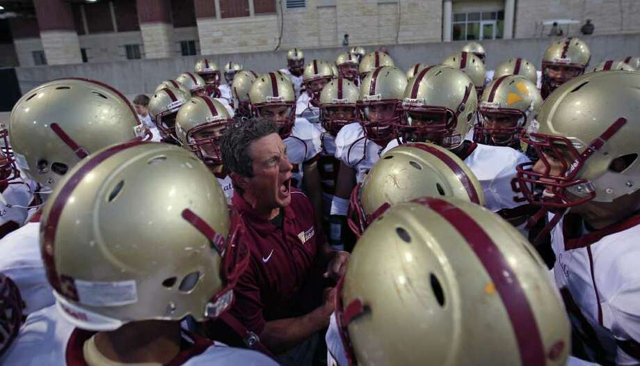 Cy-Woods assistant coach Chris Turnbow fires up his team before taking the field to face Langham Creek, Friday, October 14, 2011 at Berry Center in Cypress. Photo: Eric Christian Smith, For The Chronicle