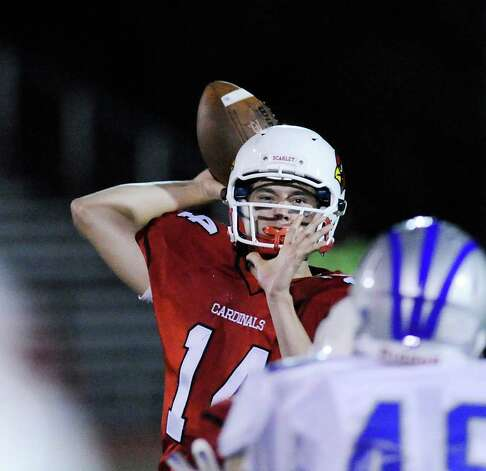 QB Liam O'Neil of Greewich throws during high school football game between Greenwich High School and Fairfield Ludlowe High School at Greenwich, Friday night, Oct. 14, 2011. Photo: Bob Luckey / Greenwich Time