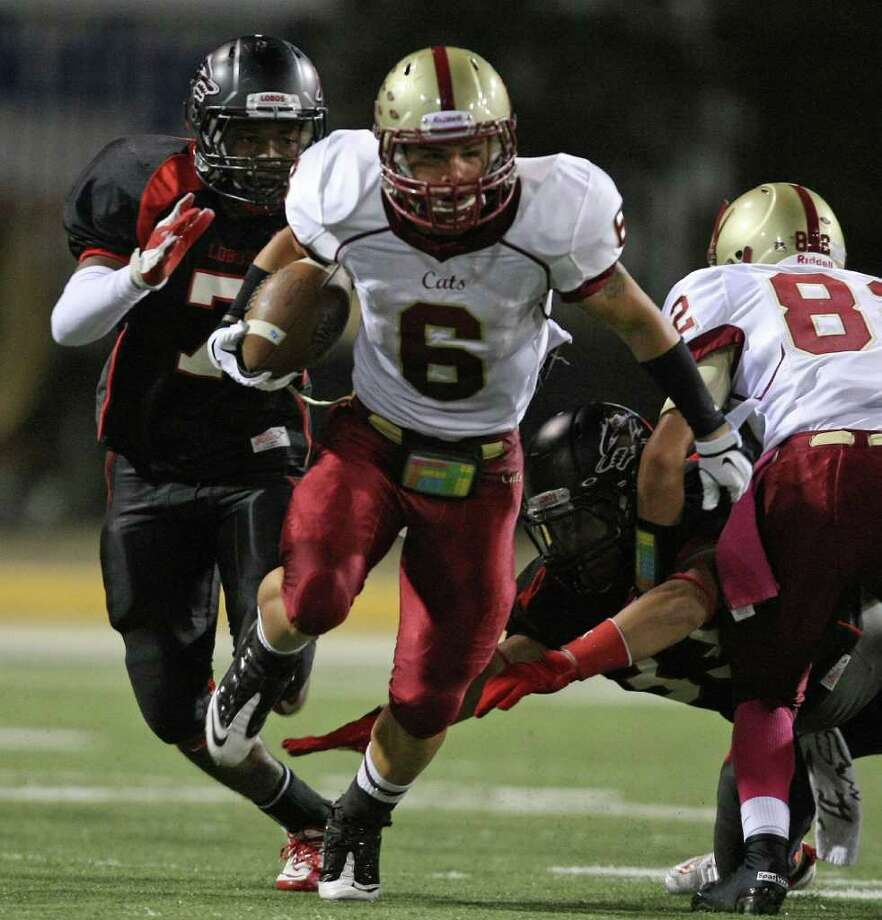 Cy-Woods' Chase Ragusa (6) scampers past Langham Creek's Jeremy land for a gain during the first half of their District 17-5A matchup, Friday, October 14, 2011 at Berry Center in Cypress. Photo: Eric Christian Smith, For The Chronicle