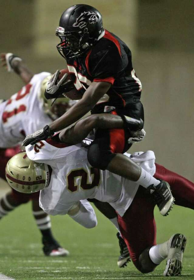 Langham Creek's Jeremiah Williams (right) is tackled by Cy-Woods' Jamaul Tompkins during the first half of their District 17-5A matchup, Friday, October 14, 2011 at Berry Center in Cypress. Photo: Eric Christian Smith, For The Chronicle