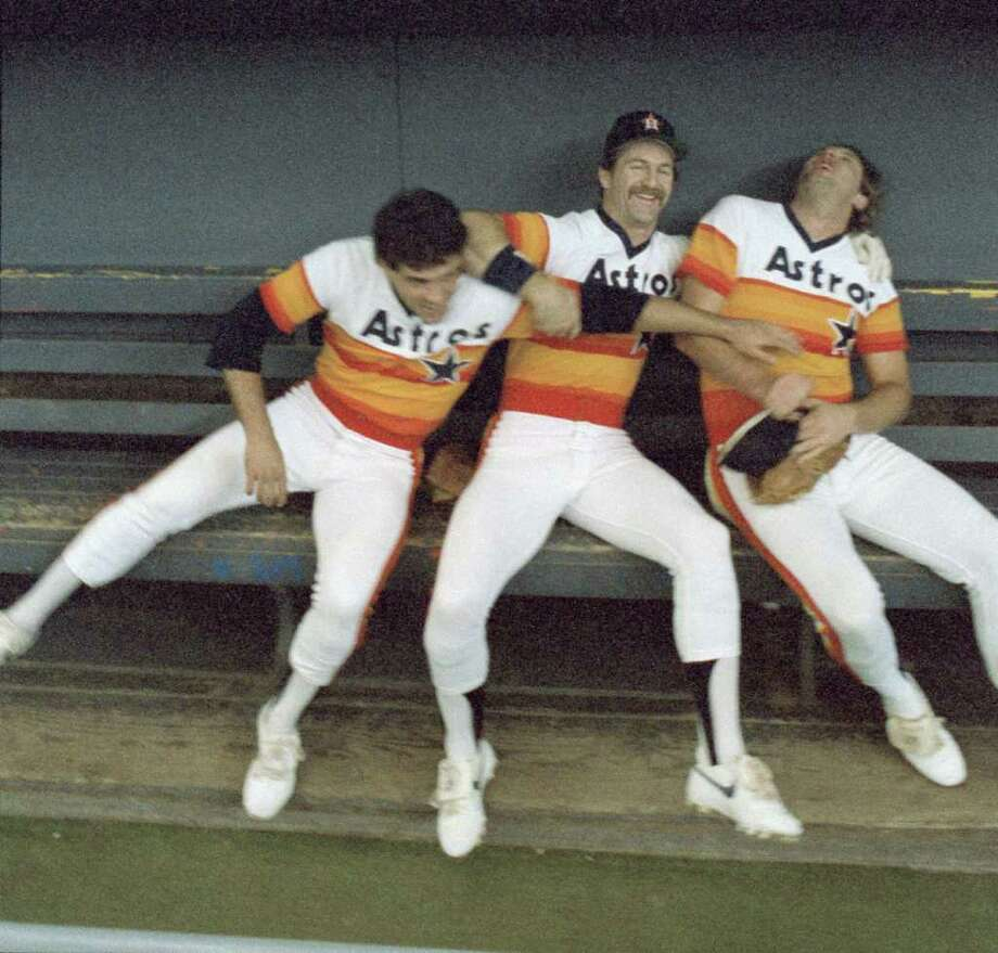 John Mizerock, Denny Walling,  Mark Bailey in the Astros' rainbow uniforms, circa 1985. Photo: Ben Desoto, Houston Chronicle / Houston Chronicle