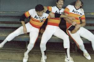 CONTACT FILED: HOUSTON ASTROS.    10/01/1985 -- Houston  Astros vs Atlanta Braves.   (l-r) John Mizerock, Denny Walling,  Mark Bailey.   HOUCHRON CAPTION (10/27/2005-3 STAR, 1ST R.O.):  OUT OF FASHION: The Astros' rainbow uniforms of the '70s and '80s and the White Sox's black-pointed-collar, shirt-untucked look of the Bill Veeck (NOT PICTURED) era are generally considered among the worst-looking uniforms of all time in sports.      SPECIAL SECTION:  WORLD SERIES 2005